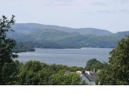 A view of Lake Windermere with the mountains in the background.