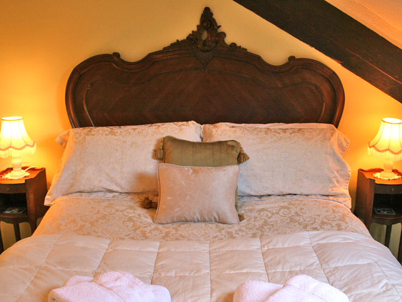 The Attic, a bedroom at Blenheim Lodge guest house, with Louis XV bed.