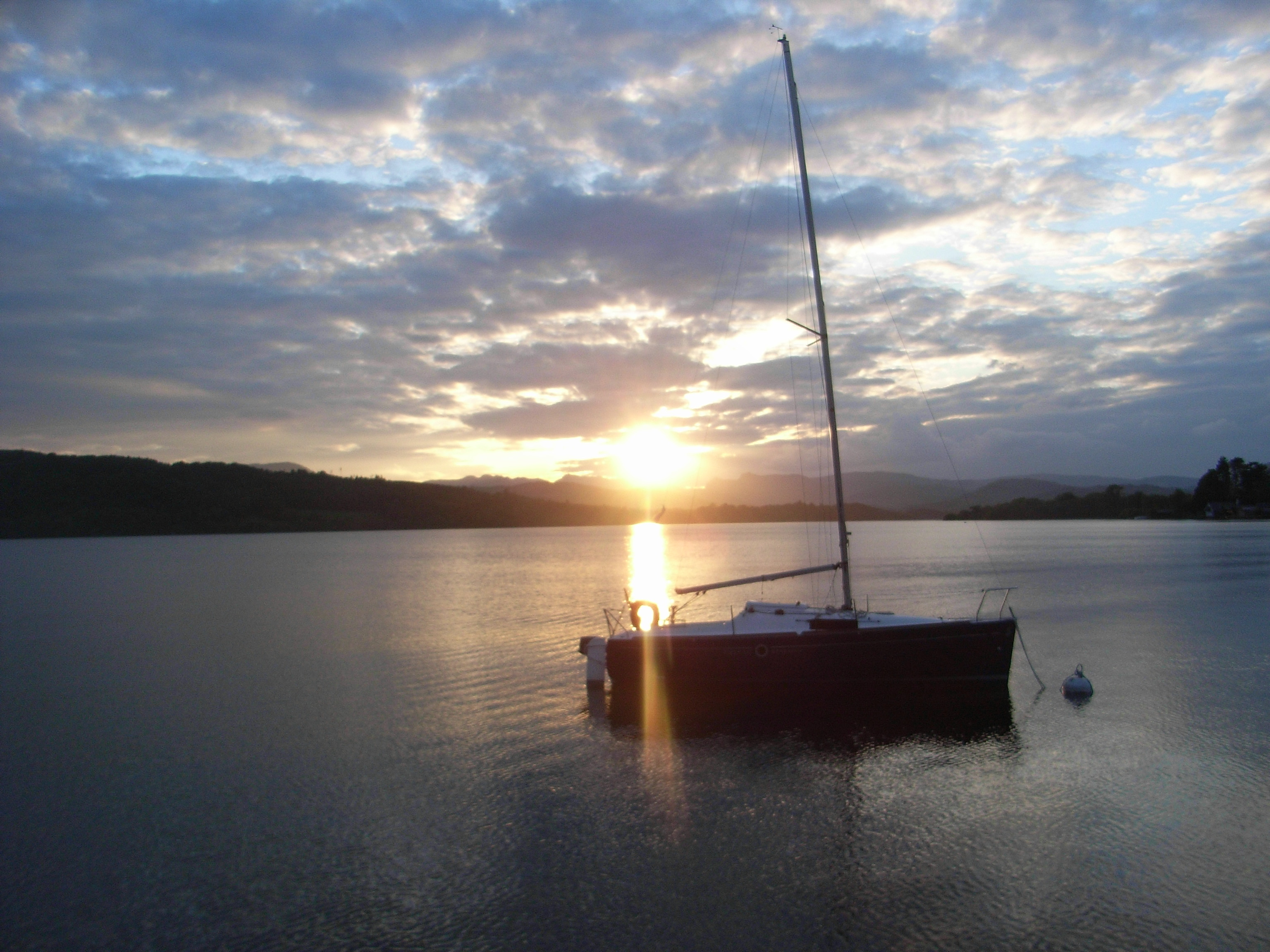 A yacht in the calm waters of Lake Windermere