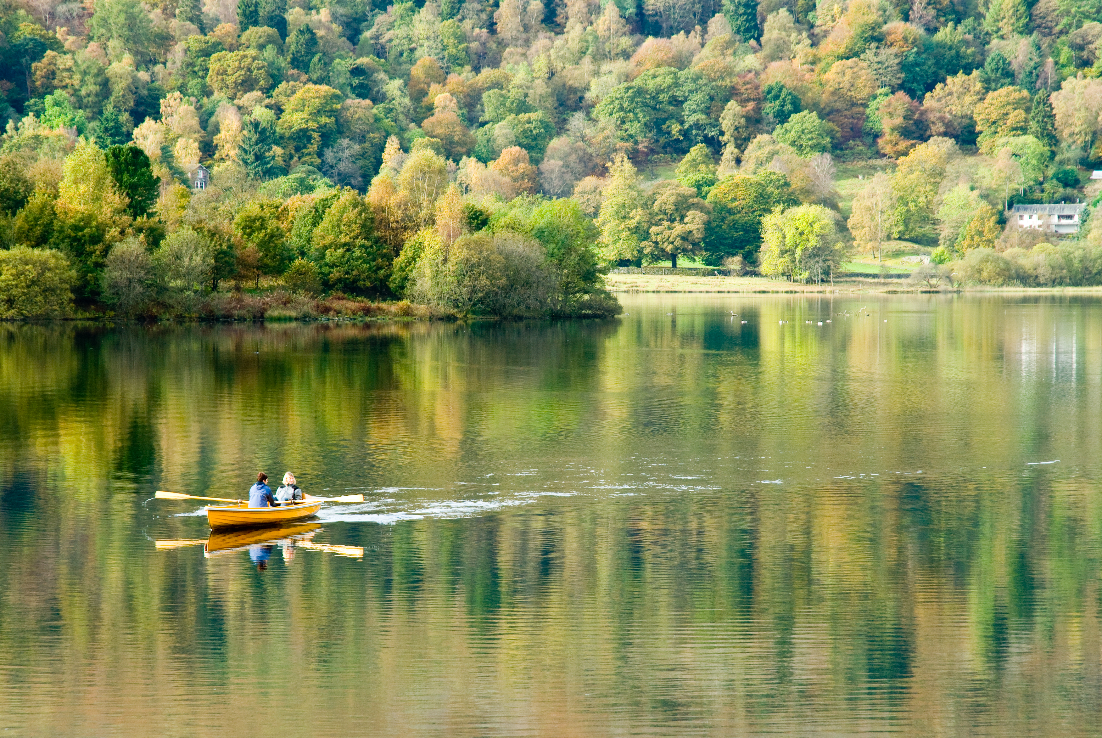 Here is a picturesque take on one of the towns/villages I have mentioned in this paragraph. Isn't this a fantastic photo of Grasmere Lake? Two canoeists row in the still deep silence of a glassy lake which reflects the beauty of its surroundings. (Photo courtesy of www.cumbriaphoto.co.uk.)