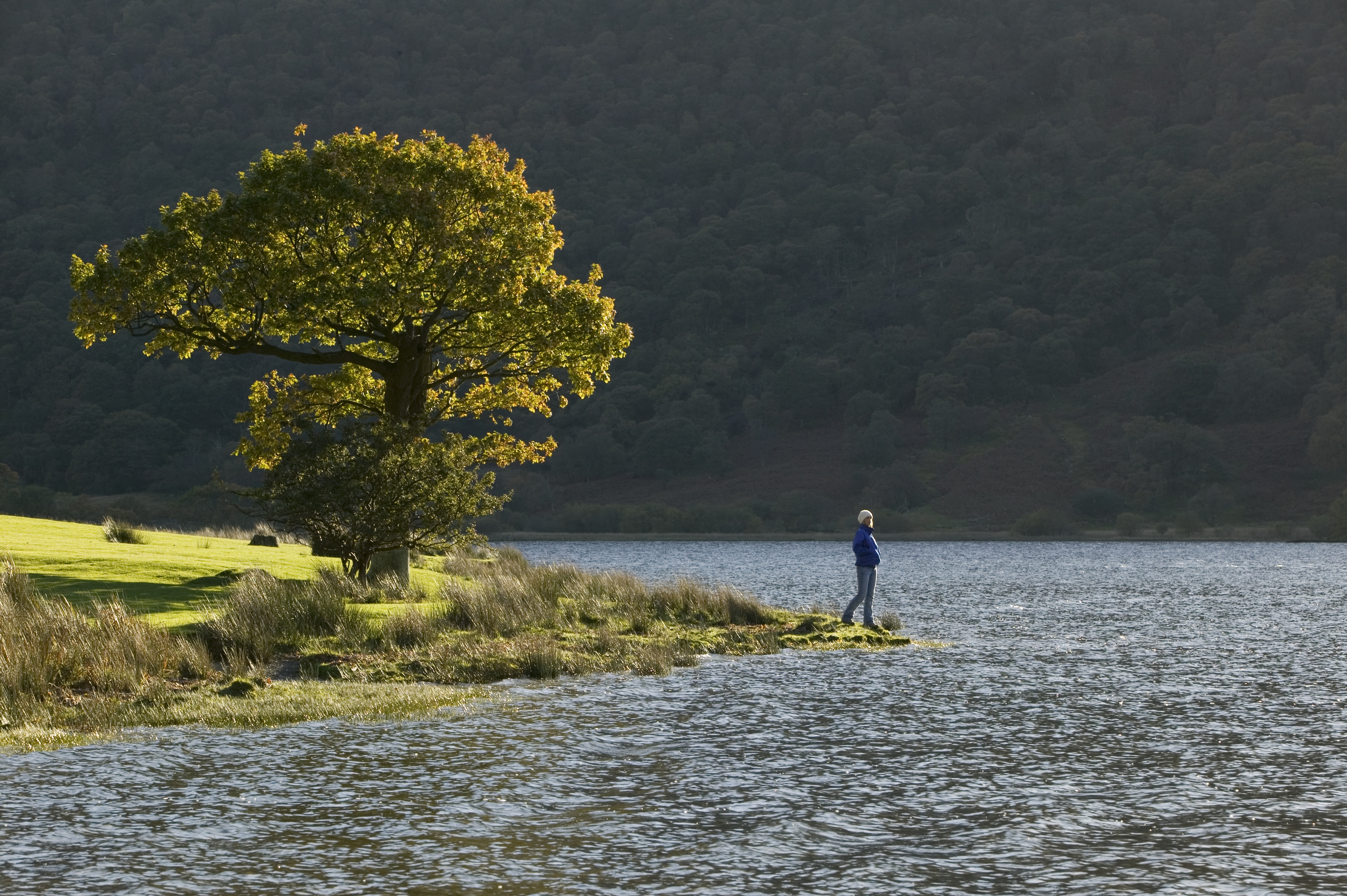 Enjoy a little solitude by a tranquil lake to rejuvenate your spirit. This is Crummock Water, where row boats are also available for hire. (Photo courtesy of www.cumbriaphoto.co.uk.)