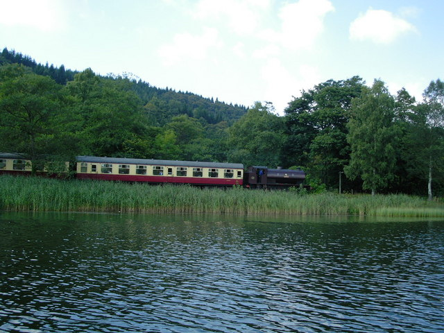 'A steam train on the preserved railway running to Lakeside on Windermere from Haverthwaite. This is taken from a rowing boat hired from the National Trust's Fell Foot Park.' (Words and photo  © Copyright DS Pugh and licensed for reuse under this Creative Commons Licence, courtesy of www.geograph.org.uk/reuse.php?id=311504.)
