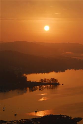 Sunrise over Windermere. (Photo courtesy of www.cumbriaphoto.co.uk.)