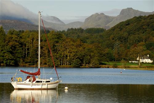 Late summer in the Lakes: I love the quality of light that is diffused in the atmosphere and reflected in the waters of the Lake District during the Autumn months. This is a photo of Lake Windermere, with the Langdale Pikes (mountains) in the background. (Photo courtesy of www.cumbriaphoto.co.uk.)