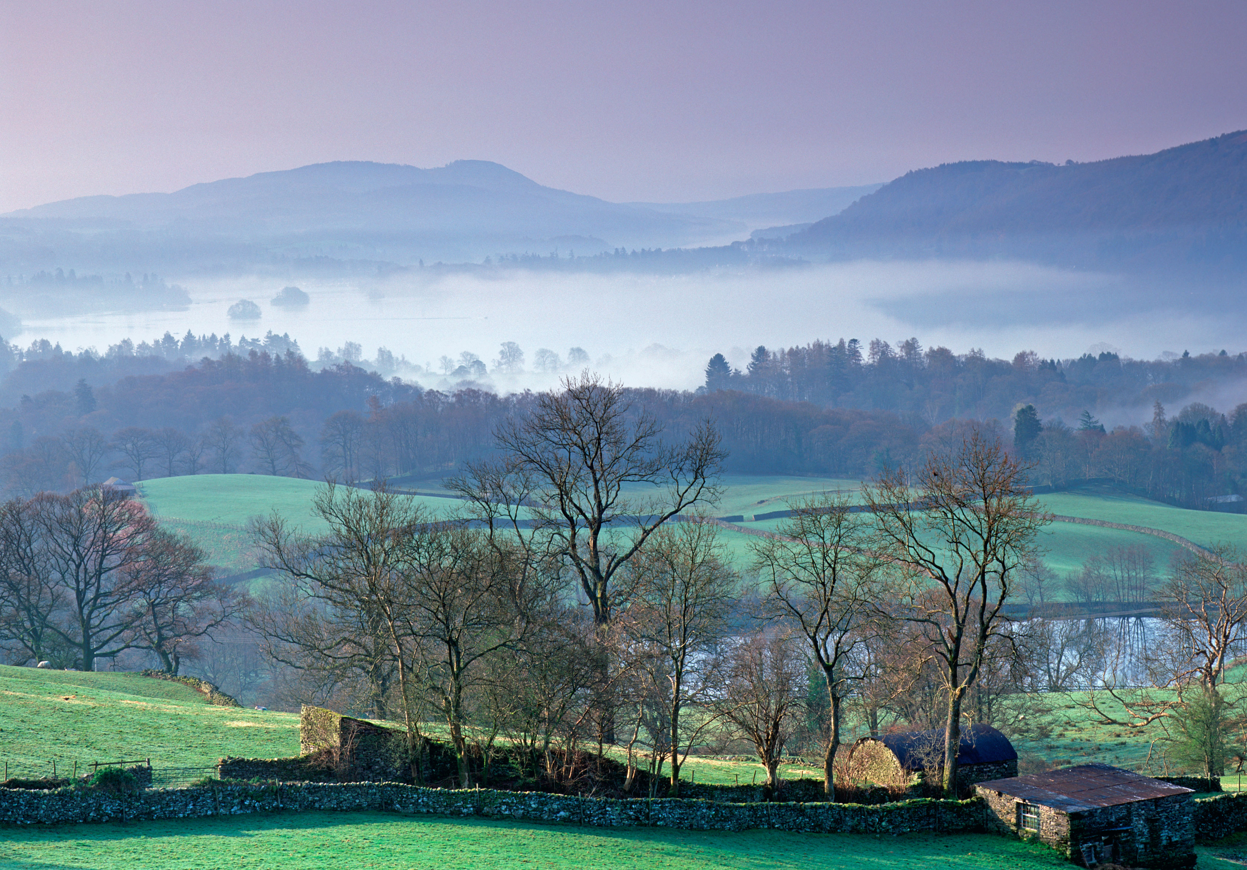 Looking South over Lake Windermere from Troutbeck. The lake is covered in mist caused by a temperature inversion common in Spring and Autumn.