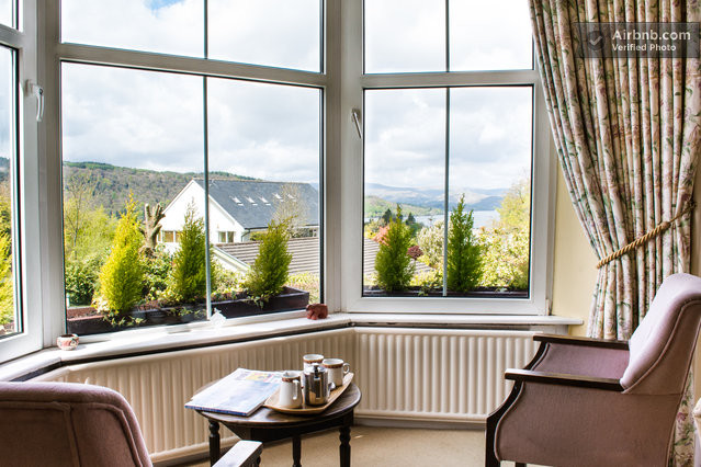 This photo of our lounge at Blenheim Lodge guest house was taken recently by a professional photographer who visited us. You can see Lake Windermere and its surrounding fells from the bay windows.