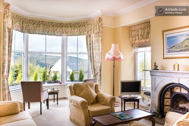 The guest lounge at Blenheim Lodge is a light-filled room, with amazing views of Lake Windermere and its surrounding fells.