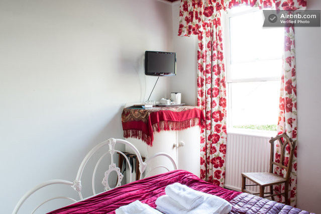 Vintage pieces and bright Laura Ashley poppy-patterned curtains provide bold dashes of colour to The Poppies room, (named, of course, after the pattern on the curtains).
