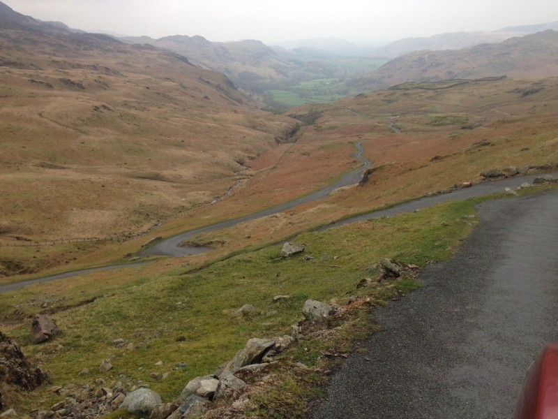 Negotiating down steep narrow tracks on Hardknott Pass, Lake District National Park.