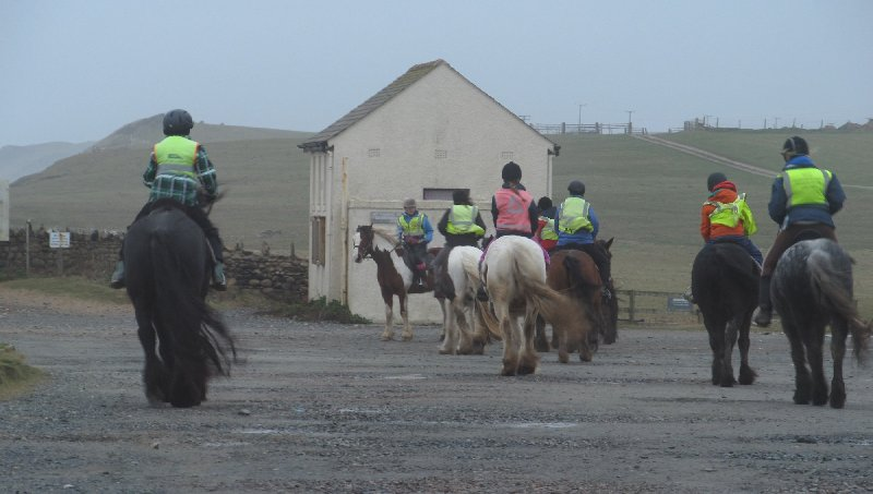 'A group of local horses and riders come for a wild walk along the foam-covered beach [at Silecroft].' Photo courtesy of www.lakelandcam.co.uk
