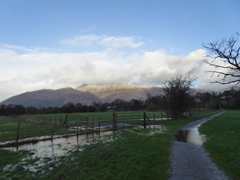 Despite the rain puddles, Skiddaw loks grand as ever. 'Skiddaw from the path from Ullock to Portinscale': photo courtesy of Ann Bowker.