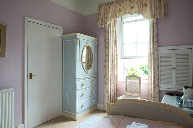 Think sweet and pretty when you look at Belle Isle, one of our single en-suite rooms at Blenheim Lodge. From the bay window can be seen gorgeous lake and fell views.