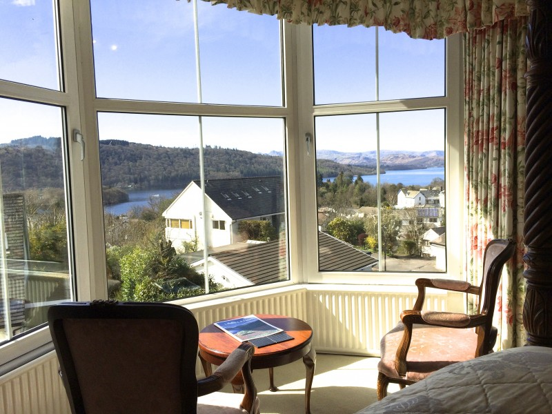 Relax before the huge triple bay windows in The Langdale room and enjoy your very own magnificent view of Lake Windermere and the fells!