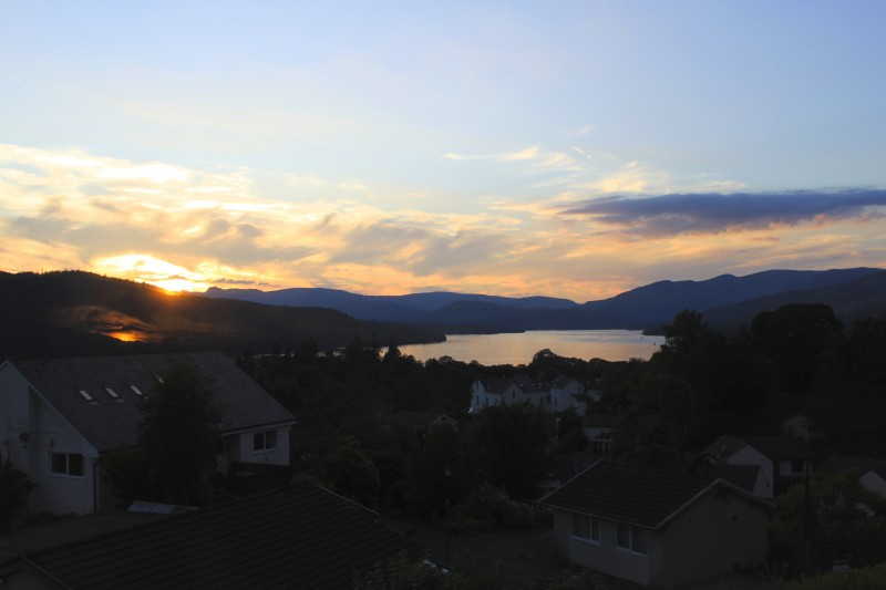 A lovely sunset view over Lake Windermere from The Fairfield bedroom at Blenheim Lodge.
