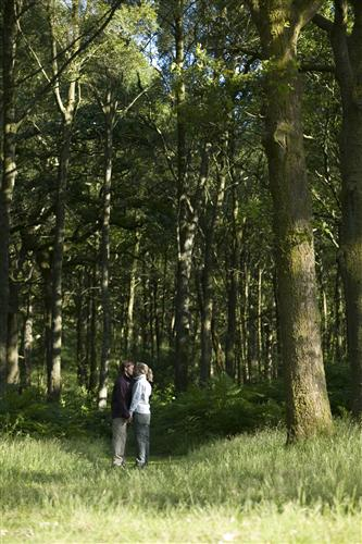 'Couple walking in woodland on the shore of Coniston Water at Machell Coppice.' Photo by Tony West.
