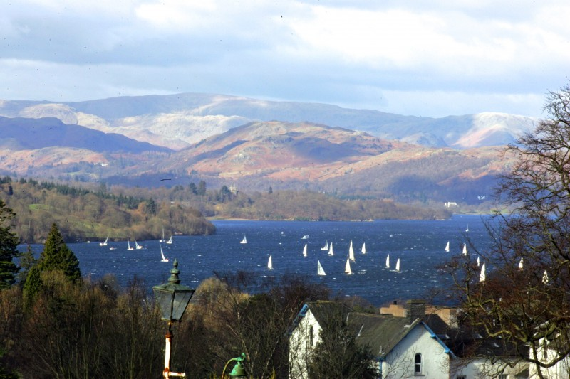 View of Lake Windermere with sailing yachts from The Coniston and other bedrooms, lounge and porch from Blenheim Lodge B&B.