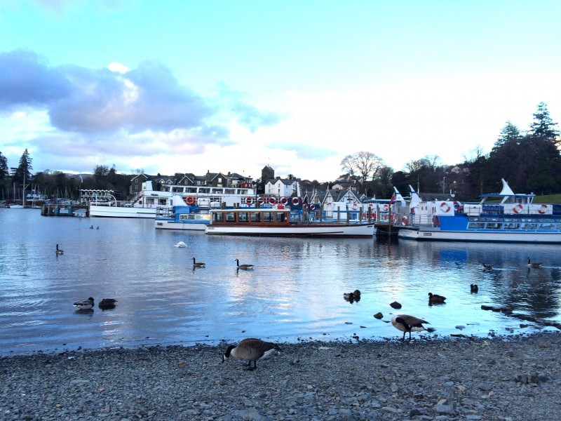 Ferries of different shapes and sizes lay up in Bowness Bay for the evening.