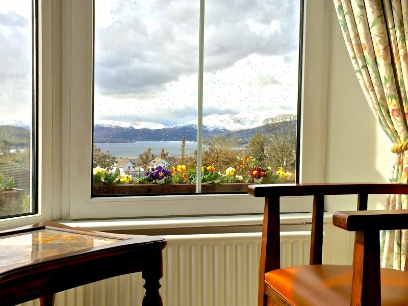 Our new chairs in the lounge offers guests a comfy seat to look out over Lake Windermere and the fells. This photo was taken after today's earlier drizzle.