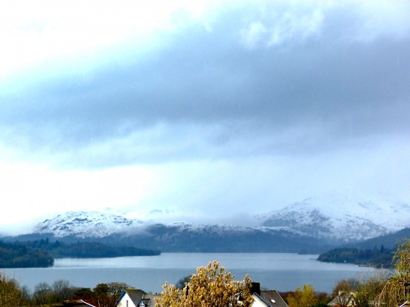 Snow fell in Bowness yesterday. This view was taken from The Attic bedroom and shows snow on the western fells.
