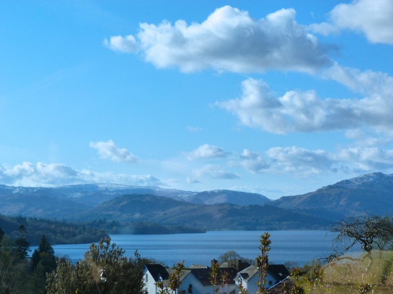 The best of both worlds! The view from our porch at Blehheim Lodge: looking down from our elevated hilltop location on Brantfell upon Bowness centre and Lake Windermere, just 2-5 minutes' walk from our front door.
