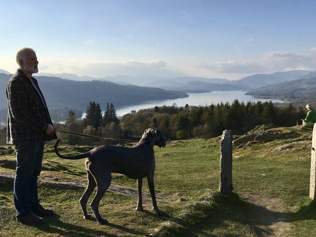Man and dog on mountain summit