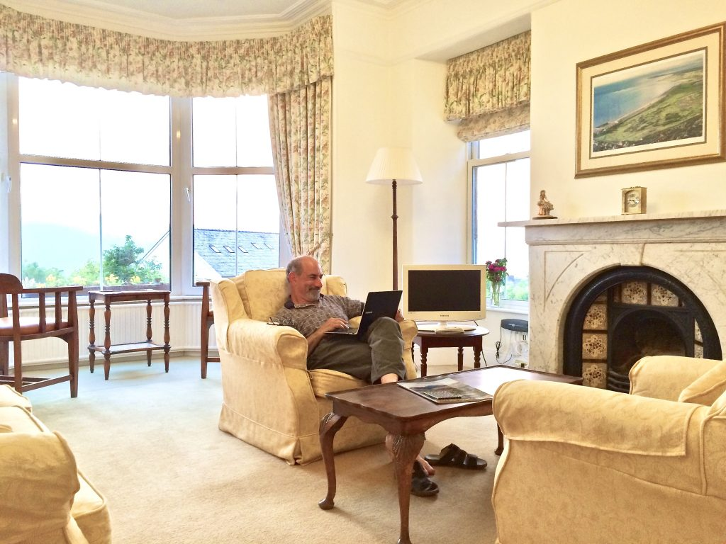 Guest uses his laptop in lounge at Blenheim Lodge
