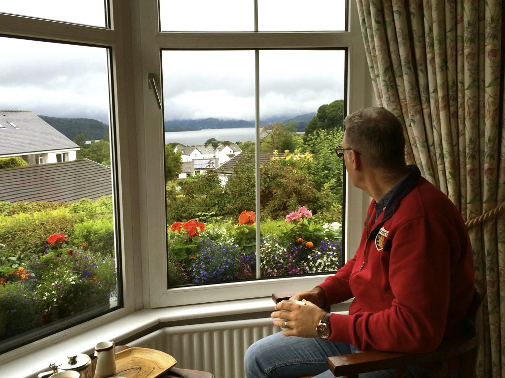 Man looking out of a window with views